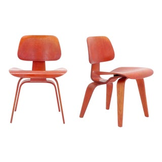 Pair of Eames DCW's, Red Aniline Dyed Ash Plywood, Original