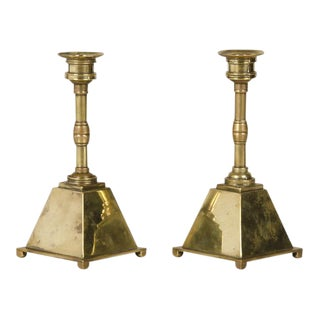 A pair of Arts and Crafts period brass candlesticks with a unique shape from England c.1885