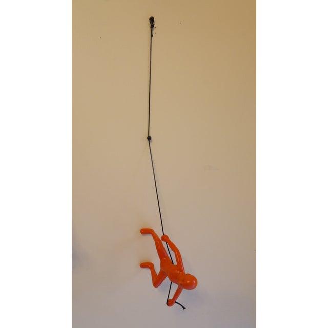 Image of Orange Exclusive Position Climbing Man Wall Art