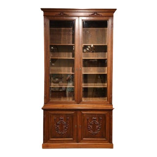 Early 20th Century French Carved Walnut Bookcase with Beveled Glass Doors