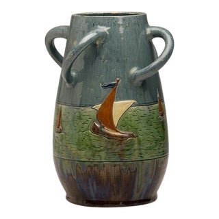 Whimsical ceramic vase with four handles in an unusual curved shape and featuring an incised motif of sailing vessels from Belgium c. 1920