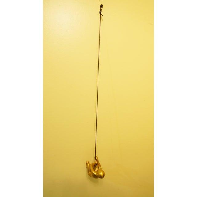 Image of Gold Climbing Man Wall Art