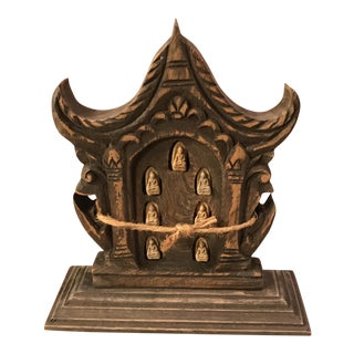 Hand-Carved Buddhist Temple Face with Buddhas