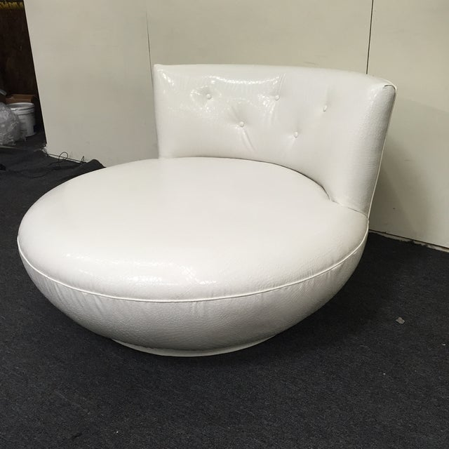 Image of Swiveling White Faux-Crocodile Skin Sofa Chair