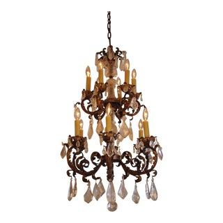 A ROCK CRYSTAL AND GILT IRON CHANDELIER