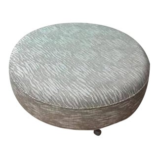 Round Gray Upholstered Ottoman
