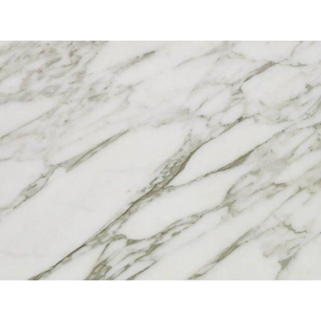 Image of White Carrara Marble Coffee Table with Ebonized Fluted Wood Base