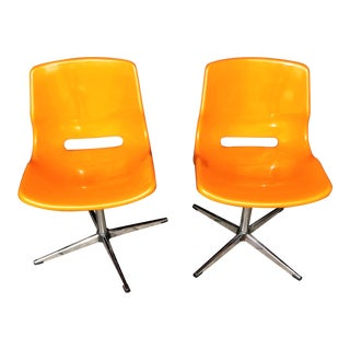Mid-Century Orange & Chrome Swivel Chairs - A Pair