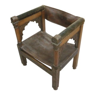 Four Franco-Islamic Carved Wood and Leather Armchairs