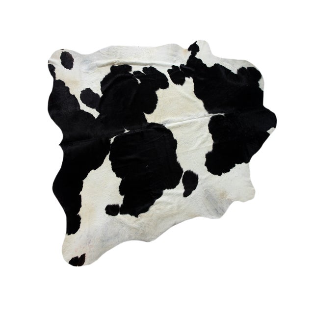 "Image of Brazilian Black & White Cowhide Rug - 7'1"" x 7'3"""