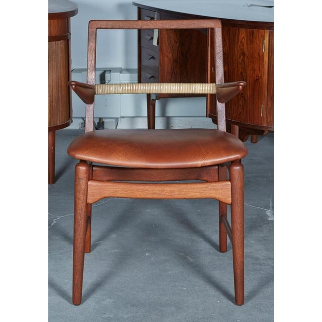 Image of Danish Teak Cane and Leather Armchair by E. Knudsen