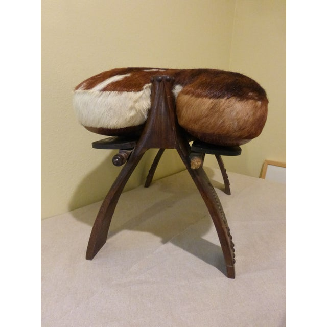 Image of Antique Camel Saddle Stool With Cowhide Cover