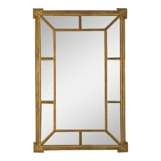 A handsome gold leaf frame in the manner designed by famed English architect Robert Adam that encloses the mirror glass from England c. 1895