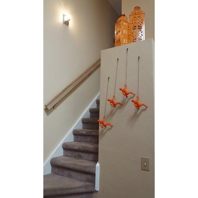 Image of Climbing Man Orange Position 1