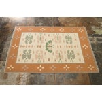 Image of Butterfly Dhurrie Handoven Wool Rug - 5′7″ × 8′5″
