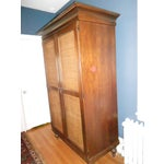 Image of Wooden Armoire With Cane Panels