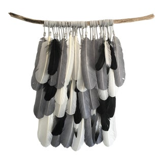 Gray, Black & White Feathers on Driftwood
