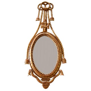 A Danish Rococo Style Carved Giltwood Oval Mirror
