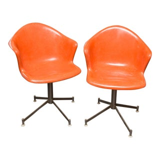 Pair of Vintage Orange Fiberglass Shell Swivel Chairs