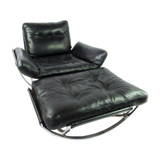 Modern Black Leather Chair and Ottoman by Stendig