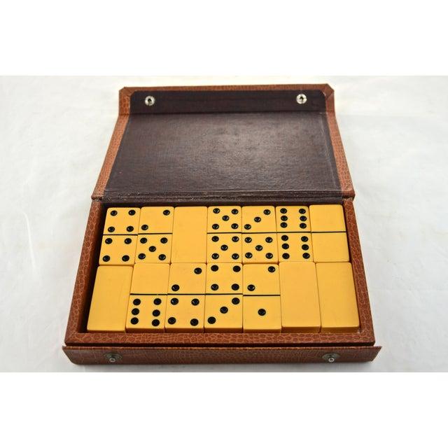 Image of Yellow Bakelite Dominoes in Brown Case