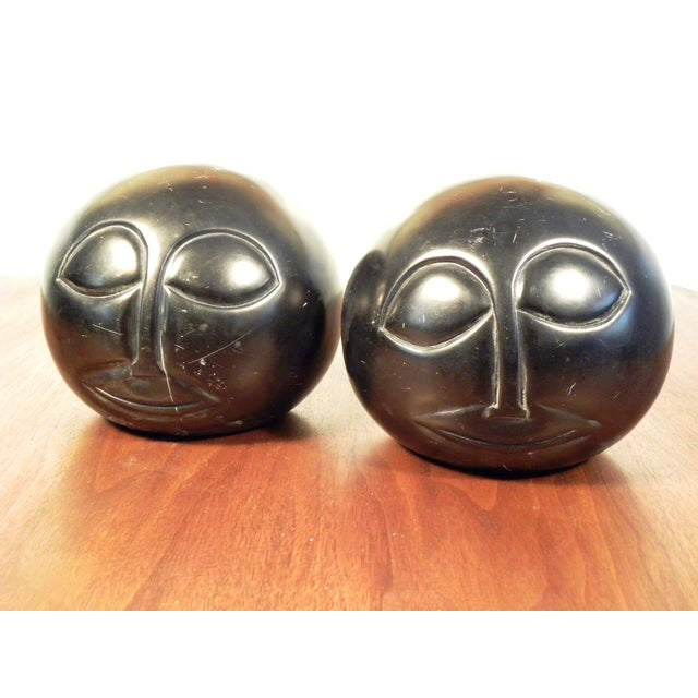 Black hand carved stone face bookends a pair chairish