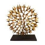 Image of Round Gold Modern Sculpture