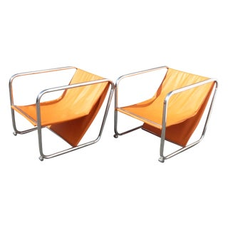 Mid-Century Orange & Chrome Lounge Chairs - A Pair