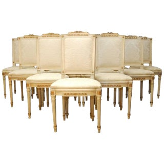 Set of Twelve Louis XVI Painted and Parcel-Gilt Dining Chairs