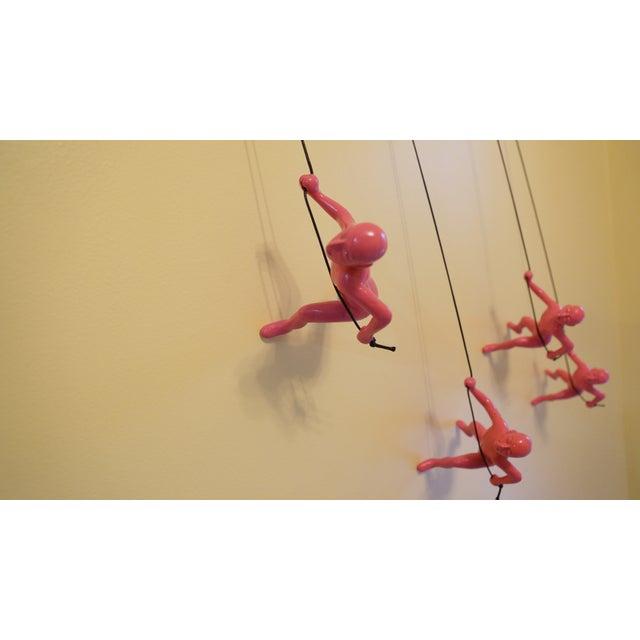 Image of Pink Climbing Man Wall Art - Set of 4