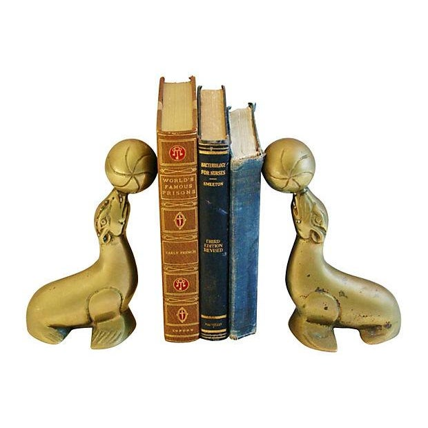 Image of Vintage 1950s Brass Seal Bookends - A Pair