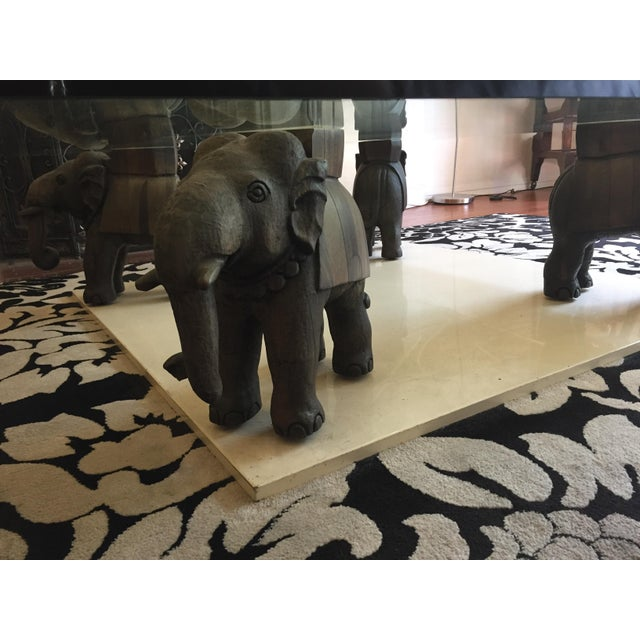 Image of Glass Coffee Table With Wooden Elephant Stands