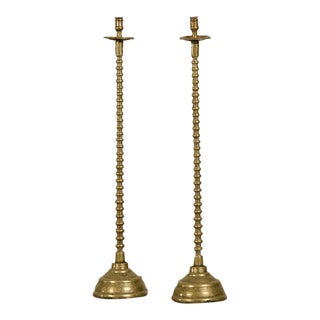 A pair of tall cast brass candlesticks from France c.1875.