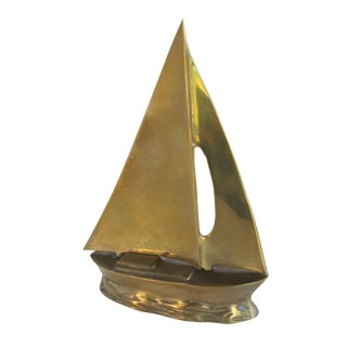 Vintage Brass Sailboat on Water