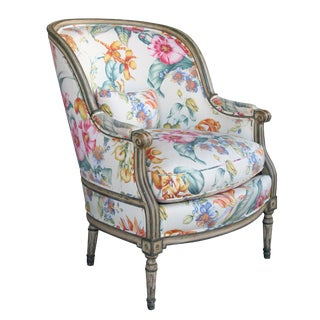 A handsome and large-scaled Louis XVI style ivory and green painted bergere with Pierre Frey Upholstery