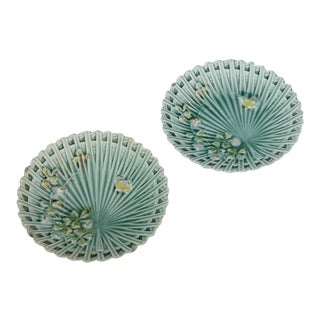 Barbotine pair of plates in a turquoise glaze having applied floral decoration, France c. 1870
