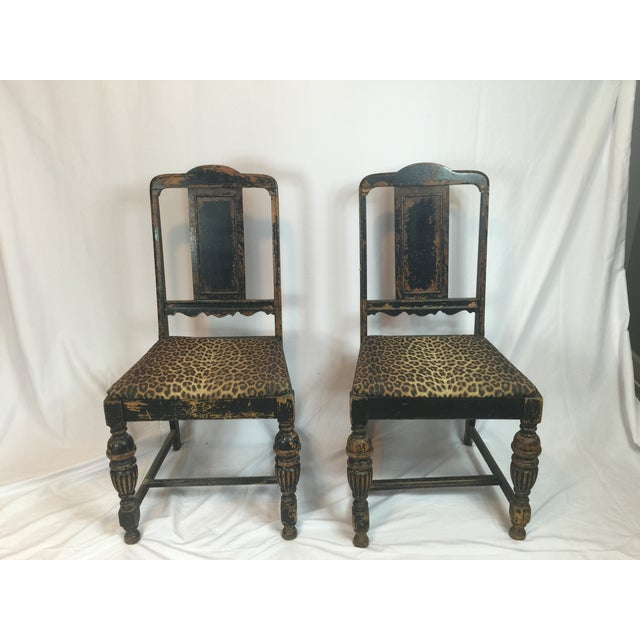 Image of Vintage Distressed Black Chairs With Leopard Print