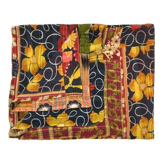 Polymorphic Poppies Rug and Relic Kantha Quilt