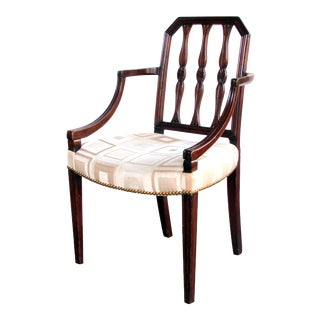 A handsome English George III Sheraton mahogany arm chair