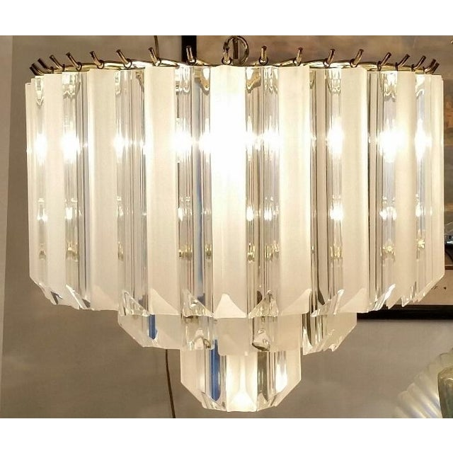 Image of VINTAGE (70s)LUCITE CLEAR AND FROSTED CHANDELIER .