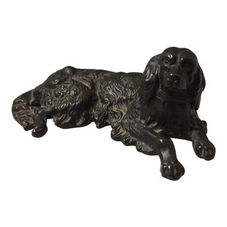 Cast Iron Laying Dog Sculpture