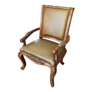 Antique Carved Leather Armchair