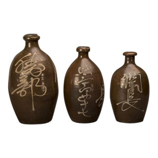 A trio of hand-made earthenware saki jars from Japan c. 1900