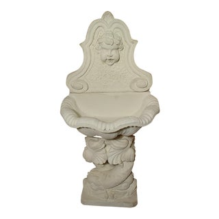 A Small Cast Stone French Dolphin Wall Fountain