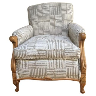 Antique Upholstered Lounge Chair With Carved Wood Accents