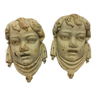 Cast Iron Cherub Faces - A Pair
