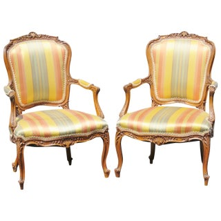 Louis XVI Style Carved Walnut Fauteuils - A Pair