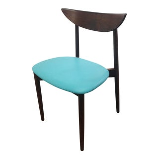 Rosewood sculptured chair with blue lambskin leather seat by Harry Ostergaard