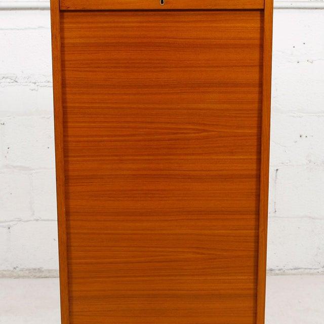 Image of Tall Teak Locking Tambour Door Jewelry Cabinet