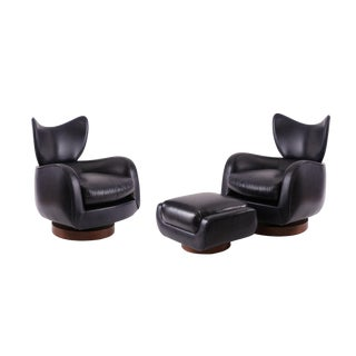 Pair of Vladimir Kagan Leather and Walnut Swivel Lounge Chairs